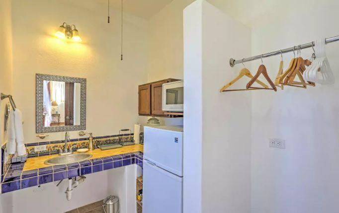 Studio Apartment B features a compact closet and kitchenette on the second floor of Casa Oasis Todos Santos Vacation Rental