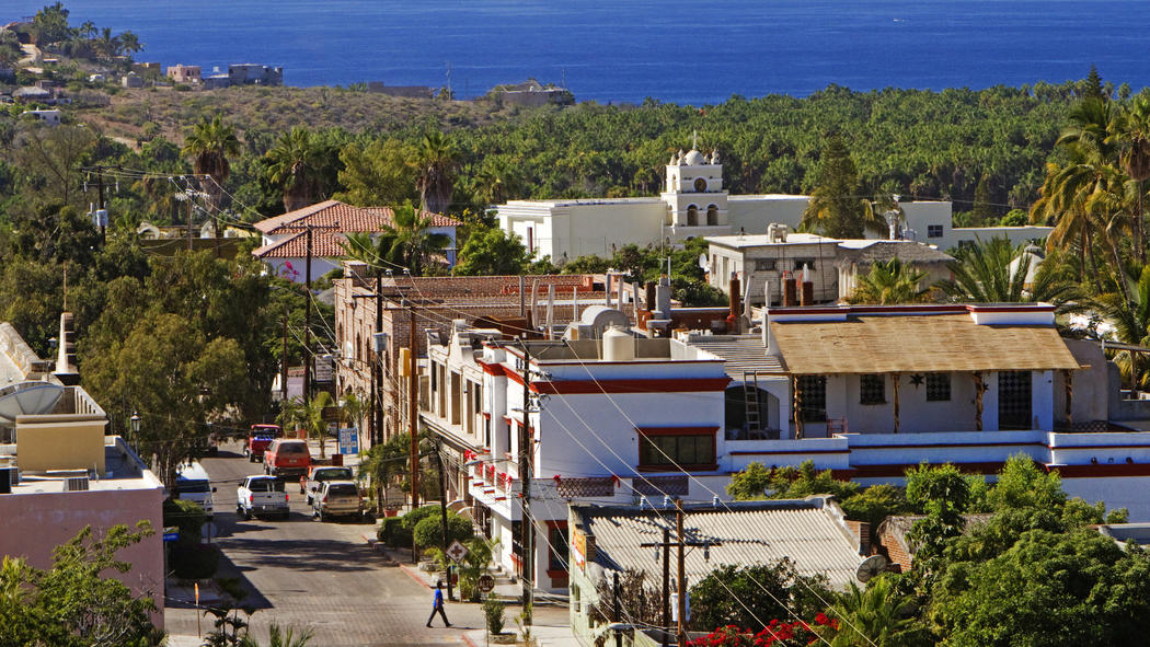 Main Street with Casa Oasis Todos Santos Vacation Rentals on hillside at top left
