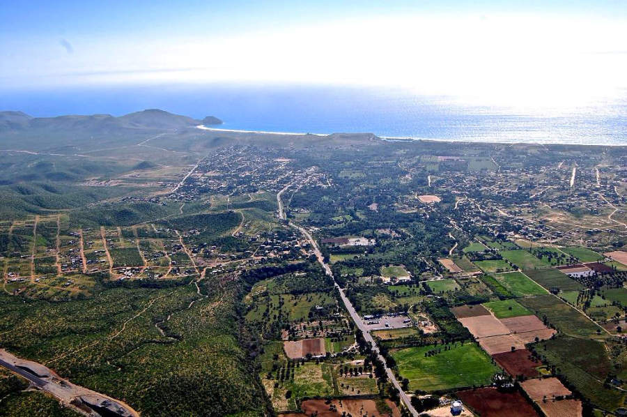 Aerial View of town with Casa Oasis Todos Santos Vacation Rental on the hillside near center